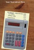 De calculator van de recessie op oude pijnboomlijst Royalty-vrije Stock Foto's