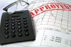 De calculator van glazen in goedgekeurd doc. stock foto