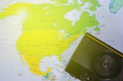 De camera legt op de kaart van Noord-Amerika Stock Afbeelding