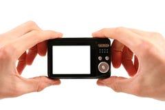 De camera van de foto in handen stock afbeeldingen