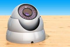 De camera van de koepelveiligheid op de houten lijst, het 3D teruggeven Stock Foto's