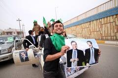 De campagnekonvooi van de verkiezing in Irak Stock Foto's