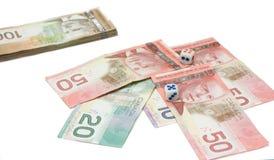De Canadese dollars met dobbelen Stock Foto's