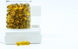 De capsule van het de olieuittreksel van rijstzemelen in luxe plastic vakje verpakking stock fotografie
