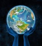 De Caraïben op aarde in handen Royalty-vrije Stock Foto