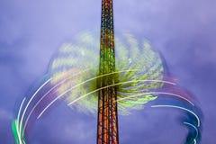De carrousel van het gevaar - groot wiel in motie bij nacht Royalty-vrije Stock Foto's