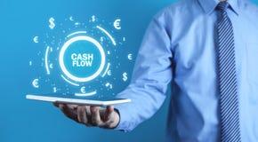 De Cash flowwoorden van de mensenholding met muntsymbolen Financiënconce royalty-vrije stock afbeelding