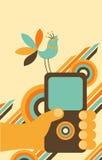 De celtelefoon van de handholding met vogel Stock Afbeelding