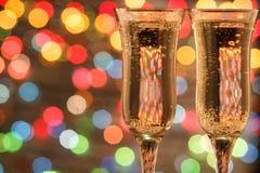 De champagne en het vuurwerk van de fles Stock Afbeeldingen