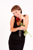 De charmante vrouw met rood nam toe royalty-vrije stock afbeeldingen