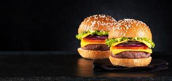 De cheeseburgers van Burgershamburgers stock foto