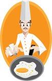 De chef-kok braadt ei Stock Afbeeldingen