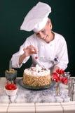 De Chef-kok die van het gebakje Kers bevlekt Royalty-vrije Stock Foto's