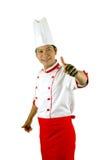 De chef-kok geeft duimen omhoog ondertekent Stock Foto's