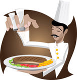 De chef-kok is toevoegt zout en peper op lapje vlees Stock Foto's