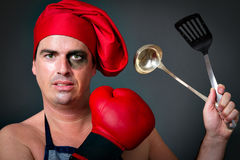 De chef-kok van de kok het olimpic in dozen doen Royalty-vrije Stock Foto's