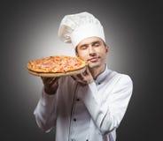 De chef-kok van de pizza stock foto