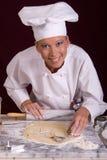 De Chef-kok van het gebakje verwijdert Koekjes Royalty-vrije Stock Foto's