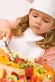 De chef-kok van het meisje met veel vruchten Royalty-vrije Stock Foto's