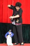De Chinese uitvoerder van het marionettenkoord Stock Foto