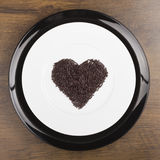 De chocolade bestrooit hart Stock Fotografie