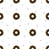 De chocolade donuts met blauw en roze bestrooit Stock Afbeeldingen