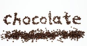De chocolade van Word die door een stapel van chocoladeschilfers wordt gevormd Royalty-vrije Stock Afbeelding