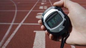 De chronometer van de handholding met tijd 15 seconden, slecht resultaat, mislukking in de concurrentie stock foto