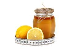 De citroen en de meter van de honing Stock Afbeelding