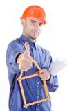 De civiel-ingenieur beduimelt omhoog Stock Foto's