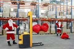 De clausulesarbeiders van de kerstman bij het werkportret Stock Afbeeldingen