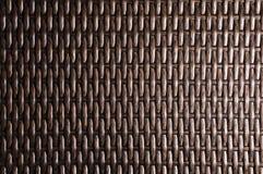 Is de close-up Donkere bruine achtergrond een element van rieten die meubilair van polymeervezels wordt gemaakt Synthetisch luxes stock afbeeldingen