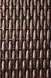 Is de close-up Donkere bruine achtergrond een element van rieten die meubilair van polymeervezels wordt gemaakt Synthetisch luxes stock fotografie