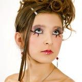 De close-up van het gezicht van meisje met speciale oogmake-up stock fotografie