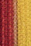 De close-up van de knipseltextuur op veelvoudig transparant rood en geel Di royalty-vrije stock afbeeldingen