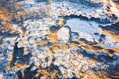 De close-uptextuur van het woestijnzand met gouden zonlicht, het Nationale Park van de Doodsvallei, Californië, de V.S. Royalty-vrije Stock Afbeeldingen