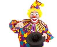De clown doet Magische Geïsoleerdeg Truc - Stock Foto