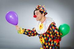 De clown met ballons in grappig concept Stock Foto