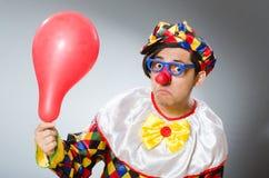 De clown met ballons in grappig concept Stock Afbeelding