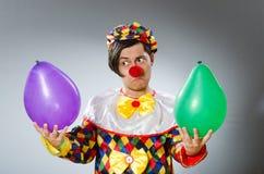De clown met ballons in grappig concept Royalty-vrije Stock Foto