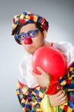 De clown met ballons in grappig concept Royalty-vrije Stock Afbeelding