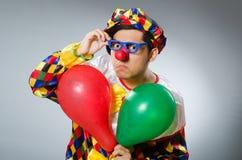 De clown met ballons in grappig concept Royalty-vrije Stock Fotografie