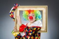 De clown met omlijsting in grappig concept Royalty-vrije Stock Foto's