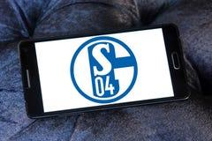 De clubembleem van de FC Schalke 04voetbal Stock Foto