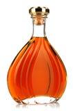 De cognac van de alcohol in een gesloten fles op wit stock fotografie