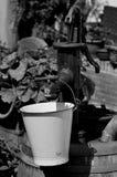 De collector en de pomp van het regenwater royalty-vrije stock afbeelding