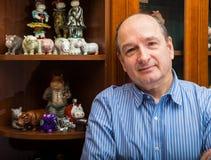 De collector en zijn hippos in een privé-collectie Stock Afbeelding