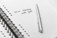 De commerciële vergadering plande op notitieboekje royalty-vrije stock afbeeldingen