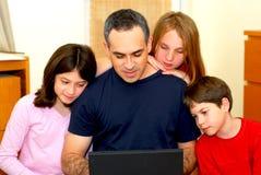 De computer van de familie Stock Foto's