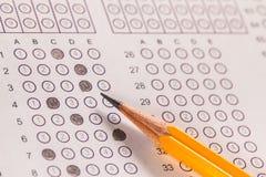 De computerblad en potlood van het examencarbonpapier Stock Afbeelding